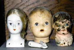 old, worn, doll heads